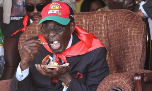mugabe-having-cake.jpeg.jpg